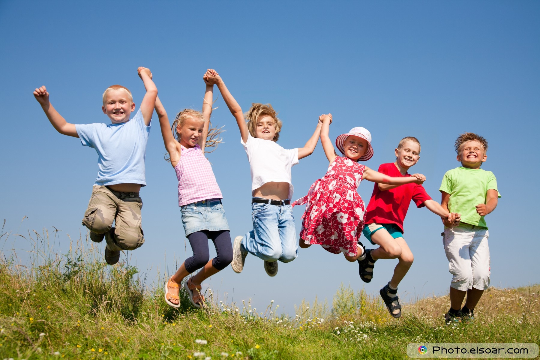 Group-happy-children-jumping-on-summer-meadow2
